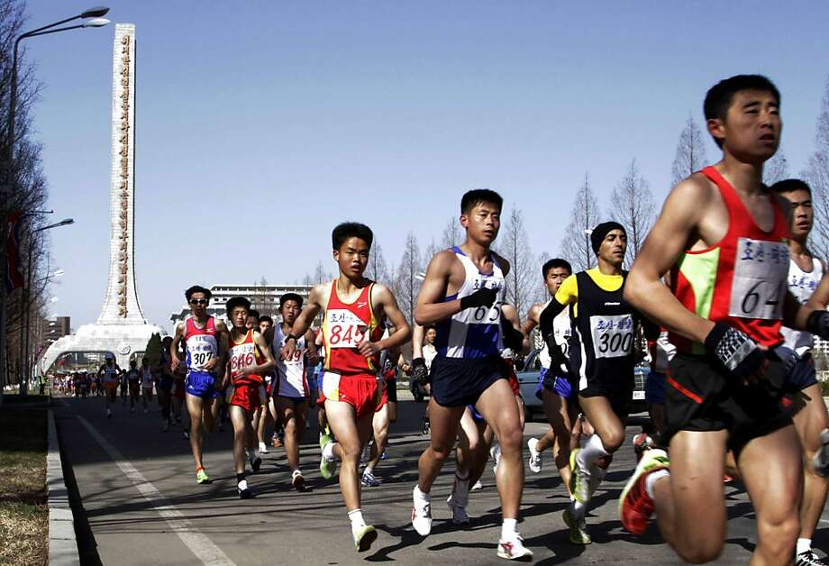 Competitors run on a street of Pyongyang's Daesong district during the 26th Mangyongdae Prize Marathon on Sunday, April 14, 2013. North Korea hosted the marathon to mark the upcoming April 15 birthday of the late leader Kim Il Sung. (AP Photo/Jon Chol Jin) Photo: Jon Chol Jin, Associated Press