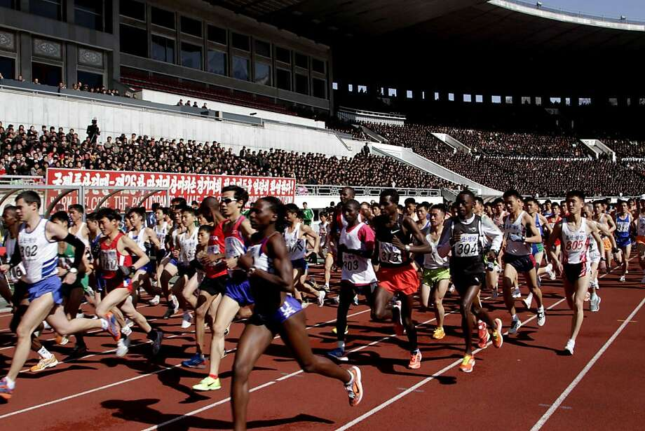 Competitors run at the start of the 26th Mangyongdae Prize Marathon at Pyongyang's Kim Il Sung Stadium on Sunday, April 14, 2013. North Korea hosted the marathon to mark the upcoming April 15 birthday of the late leader Kim Il Sung. (AP Photo/Jon Chol Jin) Photo: Jon Chol Jin, Associated Press