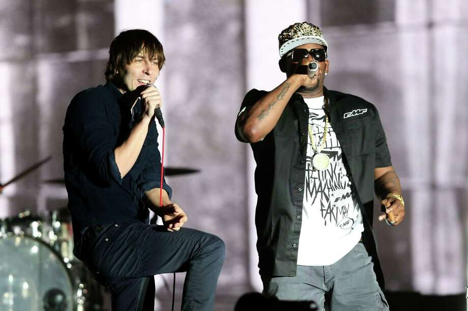 Rapper R. Kelly (R) performs with musician Thomas Mars (L) of Phoenix onstage during day 2 of the 2013 Coachella Valley Music & Arts Festival at the Empire Polo Club on April 13, 2013 in Indio, California. Photo: Christopher Polk, Getty Images / 2013 Getty Images