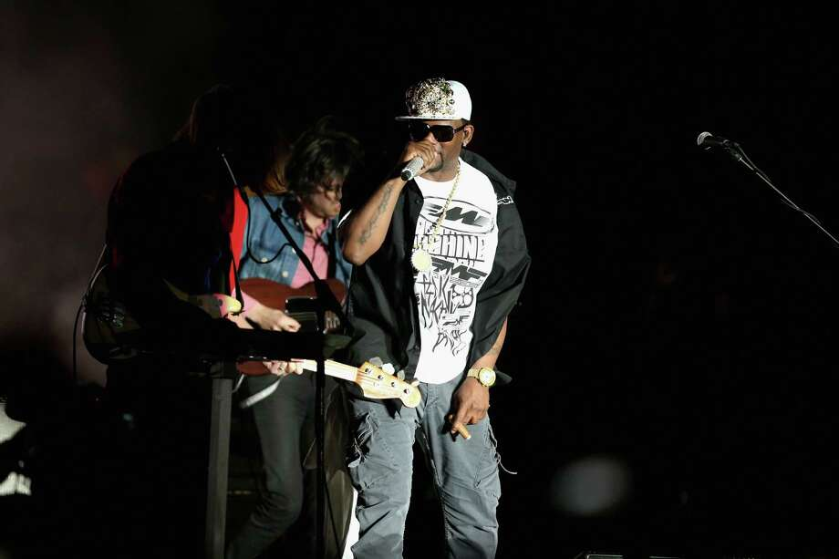 Rapper R. Kelly performs with Phoenix onstage during day 2 of the 2013 Coachella Valley Music & Arts Festival at the Empire Polo Club on April 13, 2013 in Indio, California. Photo: Christopher Polk, Getty Images / 2013 Getty Images