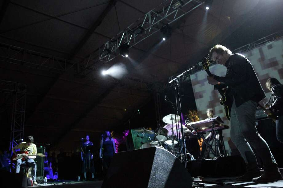 Musician Jason Pierce (L) of Spiritualized performs onstage during day 2 of the 2013 Coachella Valley Music & Arts Festival at the Empire Polo Club on April 13, 2013 in Indio, California. Photo: Karl Walter, Getty Images / 2013 Getty Images