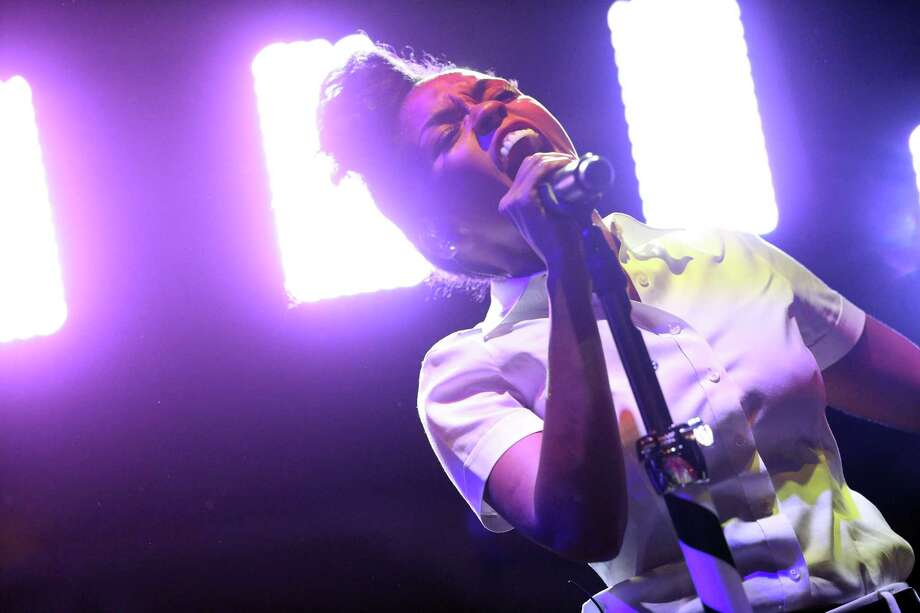Musician Janelle Monae performs onstage during day 2 of the 2013 Coachella Valley Music & Arts Festival at the Empire Polo Club on April 13, 2013 in Indio, California. Photo: Karl Walter, Getty Images / 2013 Getty Images