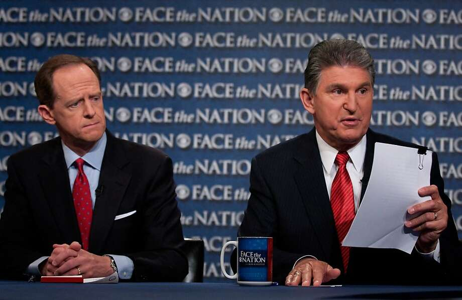"""Sens. Pat Toomey (R-Pa., left) and Joe Manchin (D-W.Va.) discuss their background checks bill on """"Face the Nation."""" Photo: Handout, Getty Images"""