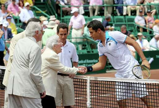 4/14/13:  Jeannie Kamrath Gonzalez , 100 years of age, meets  Nicolas Almagro (ESP) at the River Oaks US Men's Clay Court Championship at River Oaks Country Club in Houston, Texas. Gonzalez was given the Lifetime Achievement Award. She is the oldest living member of Texas Hall of Fame. Isner won 6-3, 7-5. Photo: Thomas B. Shea, For The Chronicle / © 2013 Thomas B. Shea