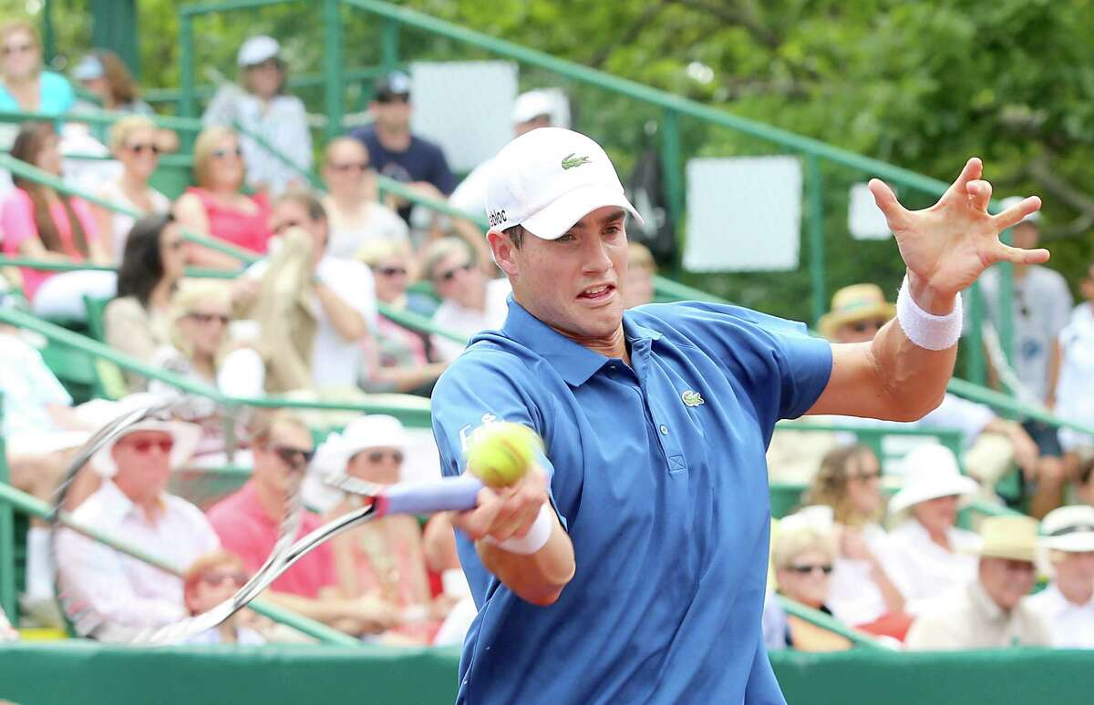 4/14/13: John Isner (USA) returns a shot to Nicolas Almagro (ESP) in the finals of the River Oaks US Men's Clay Court Championship at River Oaks Country Club in Houston, Texas. Isner won 6-3, 7-5.