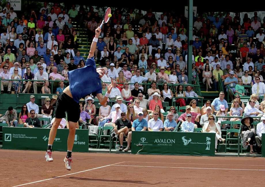 4/14/13:  John Isner (USA) serves to Nicolas Almagro (ESP)  in the  finals of the River Oaks US Men's Clay Court Championship at River Oaks Country Club in Houston, Texas. Isner won 6-3, 7-5. Photo: Thomas B. Shea, For The Chronicle / © 2013 Thomas B. Shea