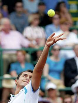 4/14/13:  Nicolas Almagro (ESP) serves to John Isner (USA) in the  finals of the River Oaks US Men's Clay Court Championship at River Oaks Country Club in Houston, Texas. Isner won 6-3, 7-5. Photo: Thomas B. Shea, For The Chronicle / © 2013 Thomas B. Shea