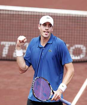4/14/13:  John Isner (USA) pumps his fist after scoring a break point against Nicolas Almagro (ESP)  in the  finals of the River Oaks US Men's Clay Court Championship at River Oaks Country Club in Houston, Texas. Isner won 6-3, 7-5. Photo: Thomas B. Shea, For The Chronicle / © 2013 Thomas B. Shea