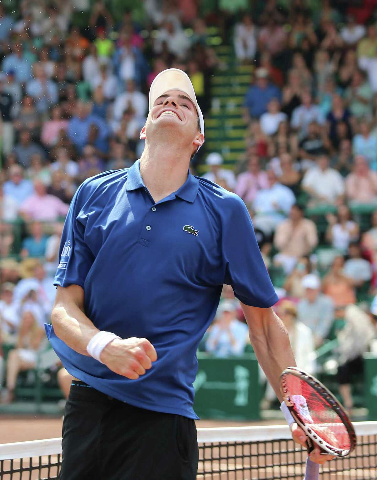 4/14/13: John Isner (USA) pumps his fist and smiles as he defeats Nicolas Almagro (ESP) in the finals of the River Oaks US Men's Clay Court Championship at River Oaks Country Club in Houston, Texas. Isner won 6-3, 7-5.