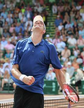 4/14/13:  John Isner (USA) pumps his fist and smiles as he defeats Nicolas Almagro (ESP)  in the  finals of the River Oaks US Men's Clay Court Championship at River Oaks Country Club in Houston, Texas. Isner won 6-3, 7-5. Photo: Thomas B. Shea, For The Chronicle / © 2013 Thomas B. Shea