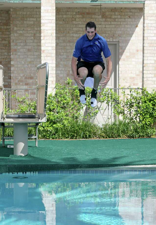 4/14/13:  John Isner (USA) jumps in the River Oaks Country Club pool after he defeated Nicolas Almagro (ESP) in the finals of the River Oaks US Men's Clay Court Championship at River Oaks Country Club in Houston, Texas. Isner won 6-3, 7-5. Photo: Thomas B. Shea, For The Chronicle / © 2013 Thomas B. Shea