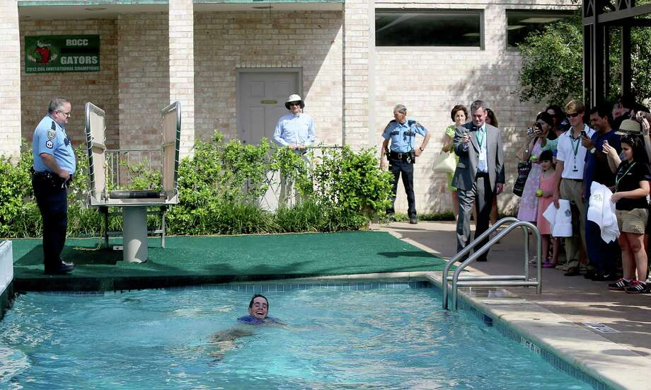 4/14/13:  John Isner (USA) swims with a smile in the River Oaks Country Club pool after he defeated Nicolas Almagro (ESP) in the finals of the River Oaks US Men's Clay Court Championship at River Oaks Country Club in Houston, Texas. Isner won 6-3, 7-5. Photo: Thomas B. Shea, For The Chronicle / © 2013 Thomas B. Shea