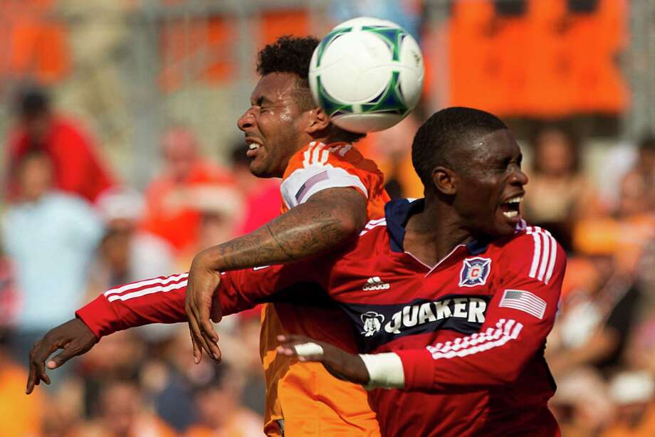 Houston Dynamo midfielder Giles Barnes, left, and Chicago Fire defender Jalil Anibaba, right, go after a ball during the first half of and MLS soccer game at BBVA Compass Stadium Sunday, April 14, 2013, in Houston. Photo: Brett Coomer, Houston Chronicle / © 2013 Houston Chronicle