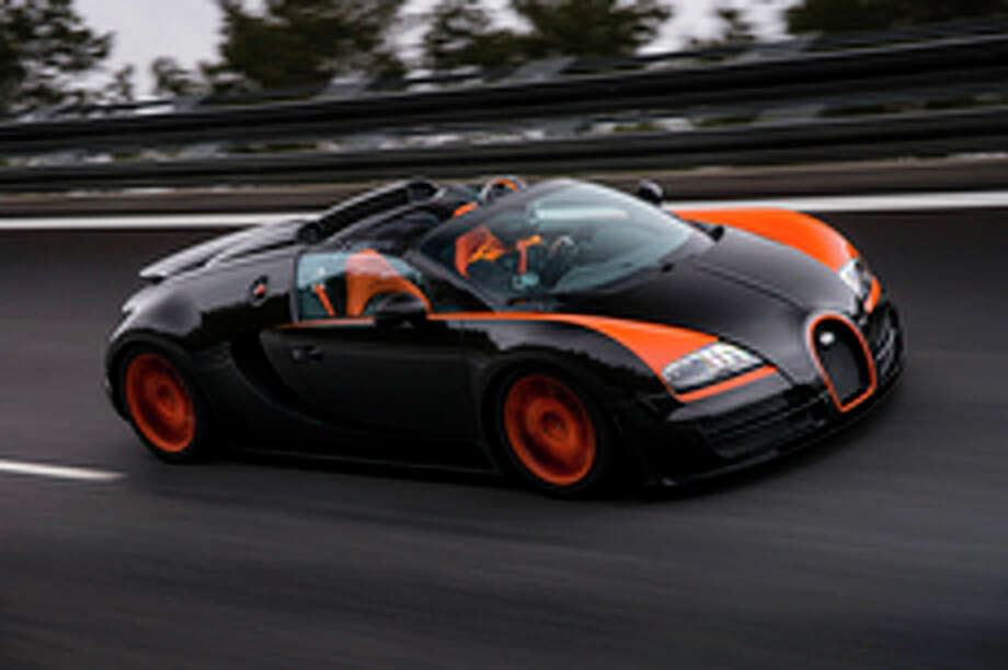 Top down, 254 miles an hour. Don\'t try this on the freeway near your house. (All photos: Bugatti/Dominic Fraser)