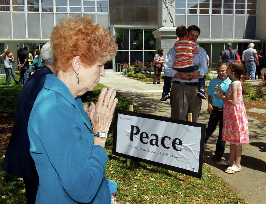 Elaine Blankenship of Kaufman takes part in a prayer walk around the Kaufman County Courthouse in Kaufman, Texas on April 14, 2013.  (Michael Ainsworth/The Dallas Morning News) Photo: Michael Ainsworth, Staff Photographer / 10017129A