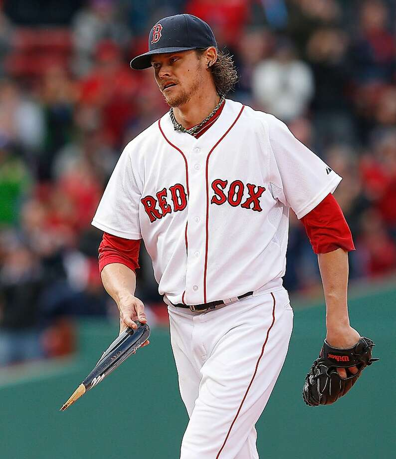 Clay Buchholz didn't allow a hit until Kelly Johnson's broken-bat single leading off the eighth inning in the Red Sox's 5-0 win over the Rays on Sunday in Boston. Photo: Jim Rogash, Getty Images