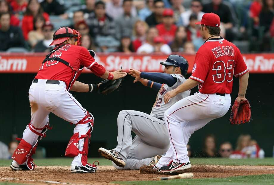 April 14: Angels 4, Astros 1 Carlos Pena is tagged out at home by catcher Hank Conger in the sixth inning. Photo: Jeff Gross, Getty Images