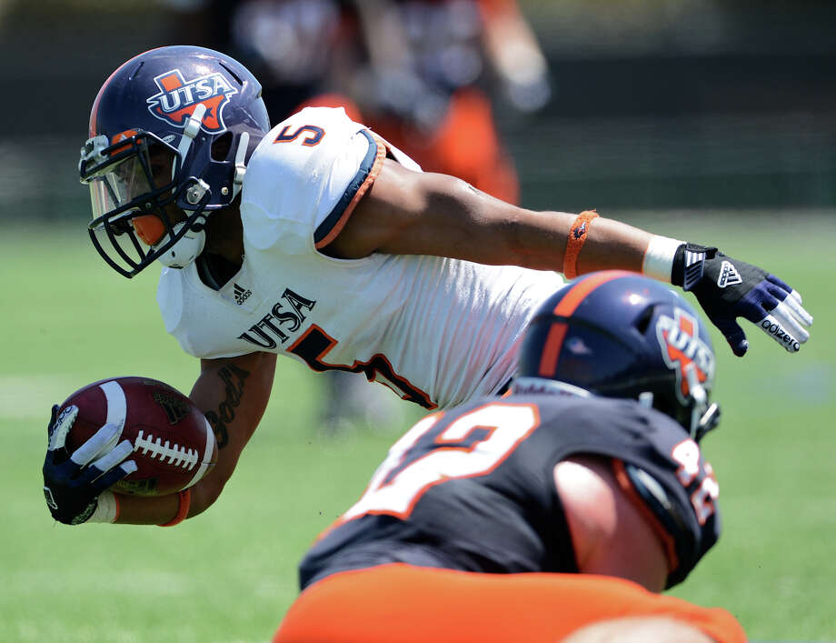 UTSA running back Brandon Armstrong (5) runs with the ball during the UTSA football spring game at the Farris Stadium, Sunday, April 14, 2013. 
