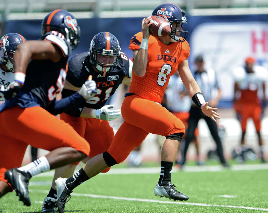 UTSA quarterback Eric Soza (8) pump fakes as he races up field during the UTSA football spring game at the Farris Stadium, Sunday, April 14, 2013. 