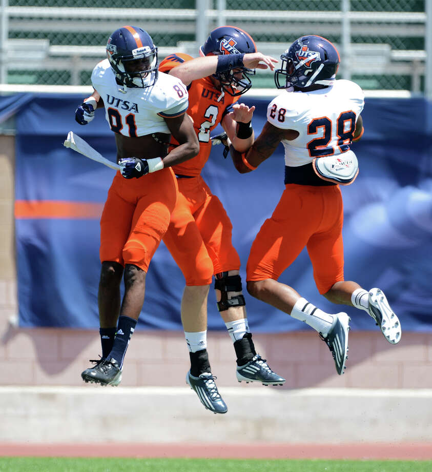 UTSA wide reciver Kenny Bias (81), quarterback Zach Conque (2) and running back Terrance Wilburn (28) celebrate after Bias caught a long touchdown pass during the UTSA football spring game at the Farris Stadium, Sunday, April 14, 2013.  John Albright / Special to the Express-News. Photo: JOHN ALBRIGHT, Express-News / San Antonio Express-News