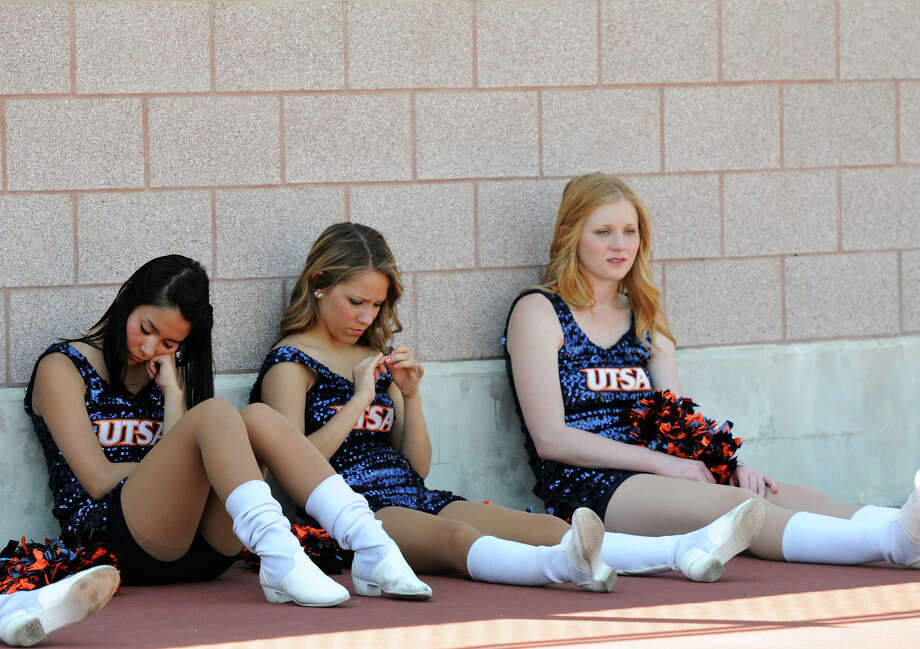 UTSA pom squad members relax in the shade during halftime of the UTSA football spring game at the Farris Stadium, Sunday, April 14, 2013. 