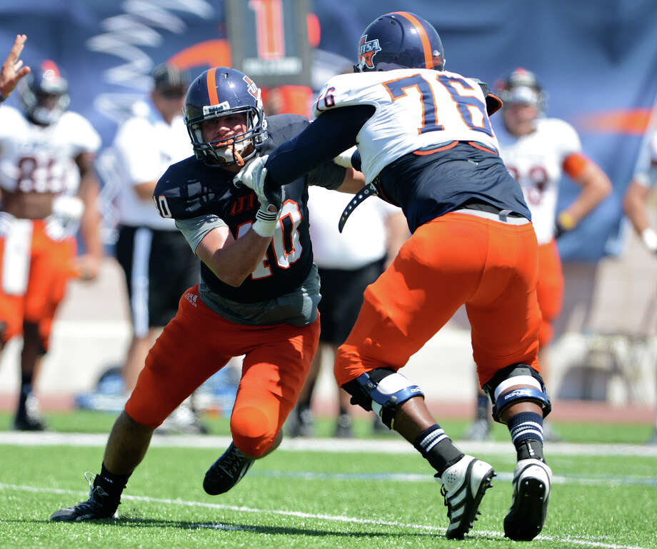 UTSA defensive end Will Ritter (40) tries to get around offensive lineman Josh Walker (76) during the UTSA football spring game at the Farris Stadium, Sunday, April 14, 2013. 
