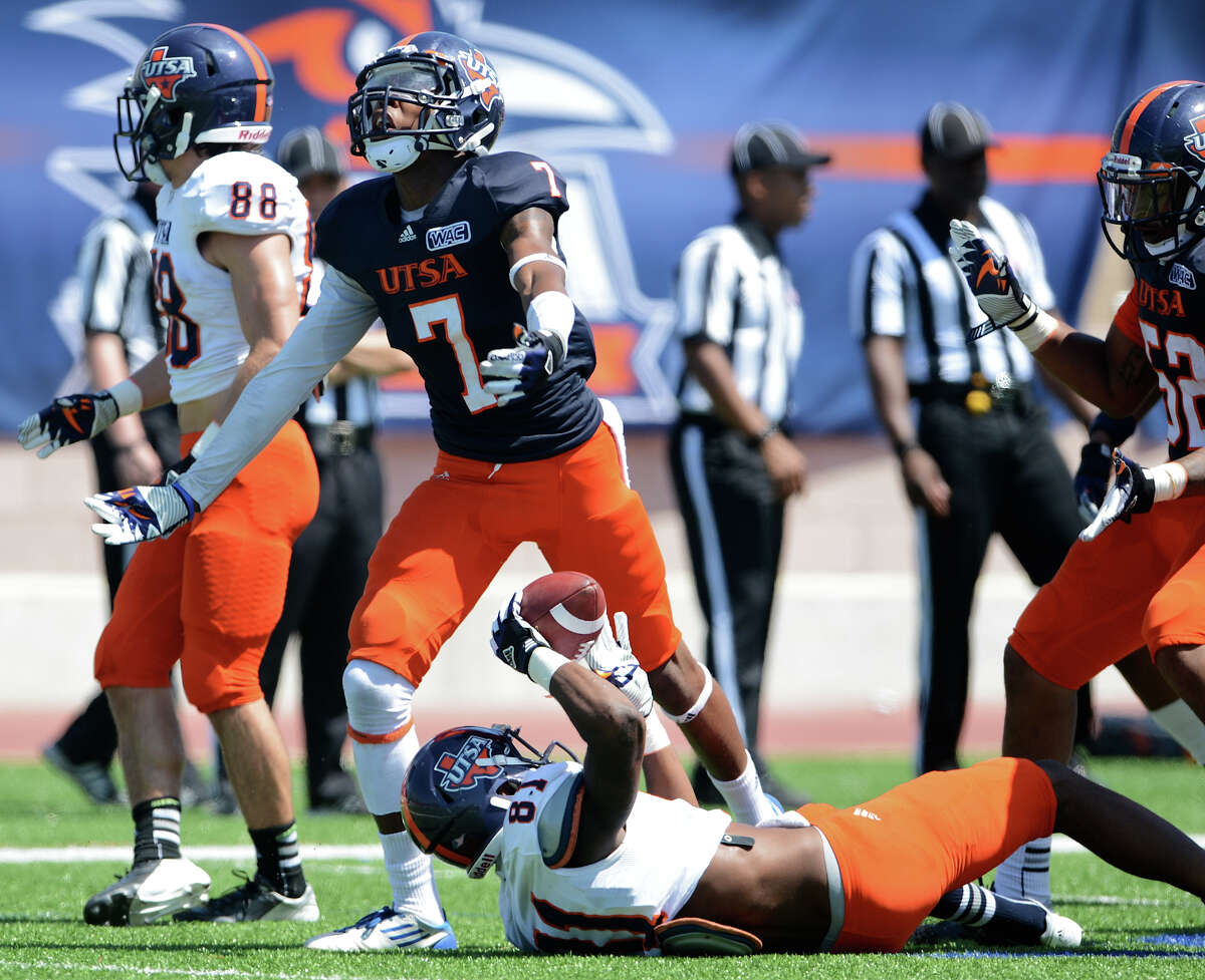 UTSA safety Triston Wade (7) celebrates after making a big hit on Kenny Bias (81) during the UTSA football spring game at the Farris Stadium, Sunday, April 14, 2013. John Albright / Special to the Express-News.
