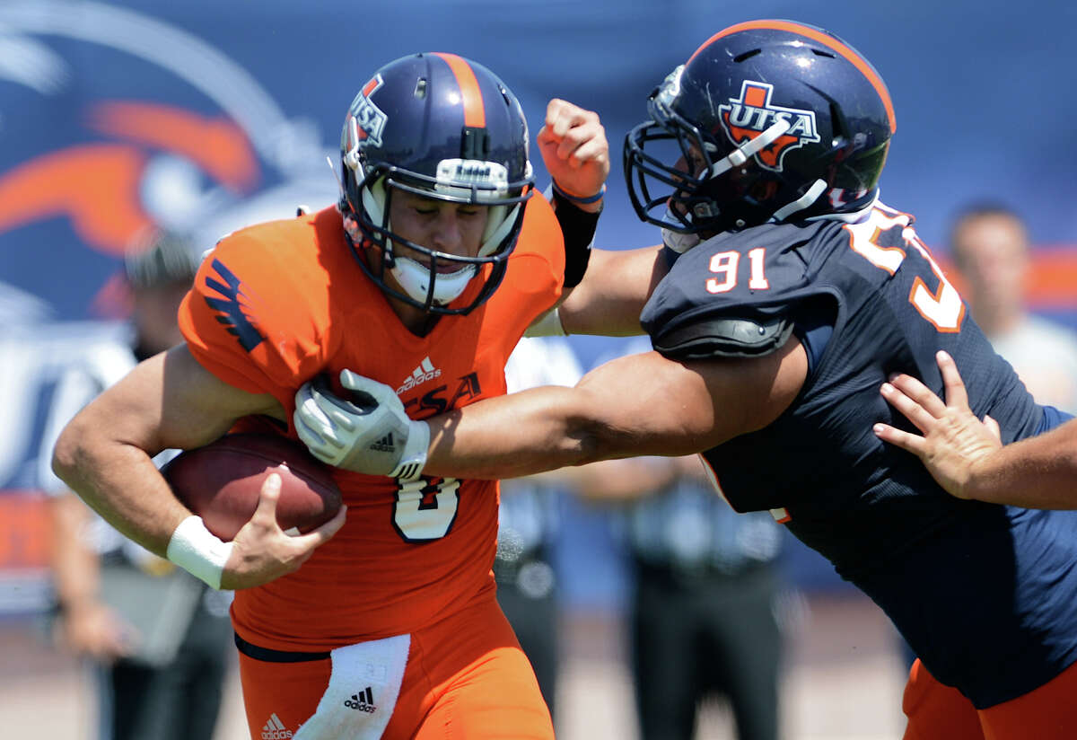 UTSA quarterback Eric Soza (8) is hit by defensive tackle Brian Price (91) during the UTSA football spring game at the Farris Stadium, Sunday, April 14, 2013. John Albright / Special to the Express-News.