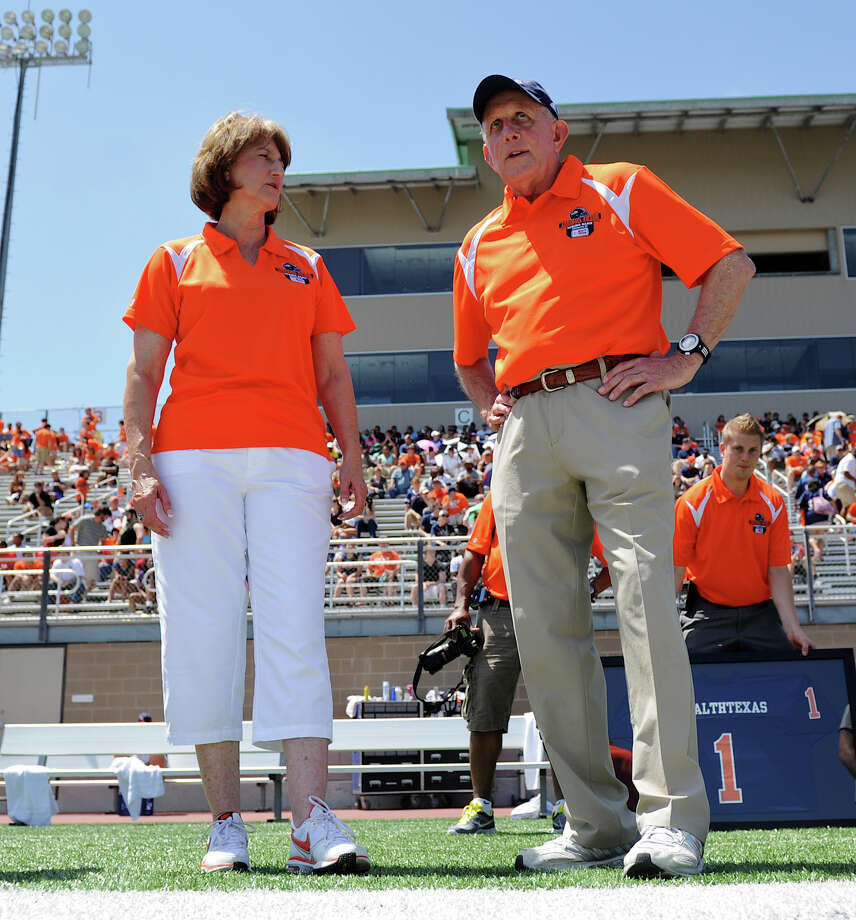 UTSA Athletic Director Lynn Hickey (left) talks to head coach Larry Coker (right) on the sideline before the UTSA football spring game at the Farris Stadium, Sunday, April 14, 2013. 