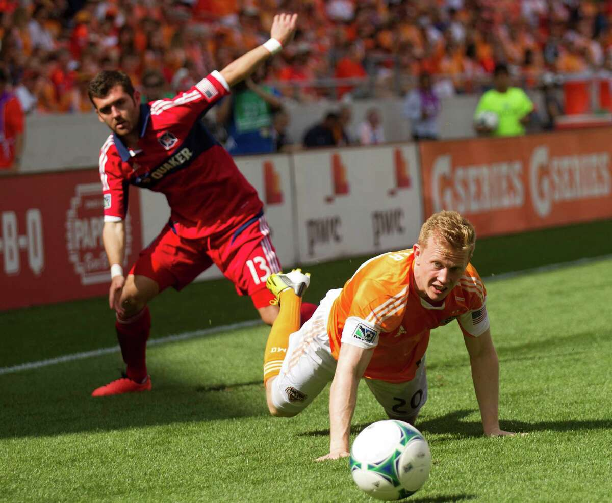 Houston Dynamo midfielder Andrew Driver (20) and Chicago Fire defender Gonzalo Segares (13) get tangled up going after a ball during the first half of and MLS soccer game at BBVA Compass Stadium Sunday, April 14, 2013, in Houston.