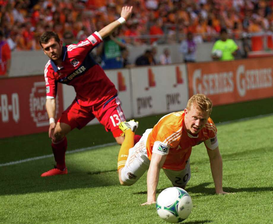 Houston Dynamo midfielder Andrew Driver (20) and Chicago Fire defender Gonzalo Segares (13) get tangled up going after a ball during the first half of and MLS soccer game at BBVA Compass Stadium Sunday, April 14, 2013, in Houston. Photo: Brett Coomer, Houston Chronicle / © 2013 Houston Chronicle