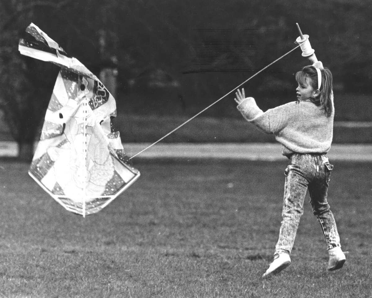 After a bit of a struggle with the wind on April 19, 1988, Anne Marie D'Andrea, 8, got her kite airborne during a kite-flying contest held at the West Beach soccer field.