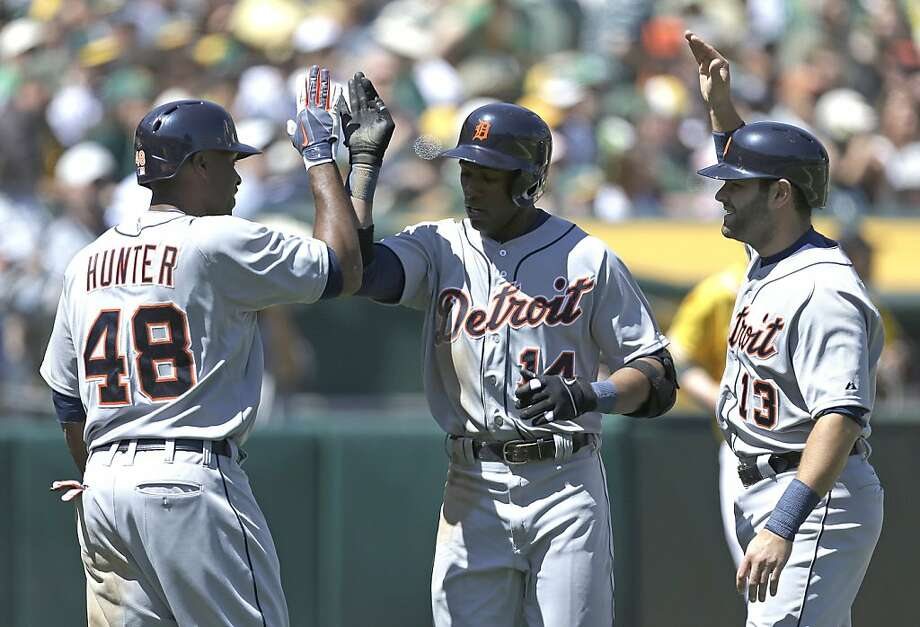 Detroit Tigers' Austin Jackson, center, is congratulated by Torii Hunter (48) and Alex Avila (13) after Jackson hit a two run home run off Oakland Athletics' Jarrod Parker in the second inning of a baseball game Sunday April 14, 2013, in Oakland, Calif. (AP Photo/Ben Margot) Photo: Ben Margot, Associated Press