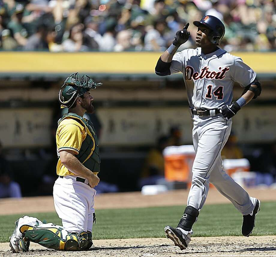Detroit Tigers' Austin Jackson, right, points skyward as he passes Oakland Athletics catcher Derek Norris, left, after hitting a two-run home run off Oakland pitcher Jarrod Parker in the second inning of a baseball game on Sunday, April 14, 2013, in Oakland, Calif. (AP Photo/Ben Margot) Photo: Ben Margot, Associated Press