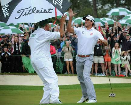 Adam Scott of Australia celebrates with his caddie Steve Williams after sinks a birdie putt on the 18th during the fourth round of the 77th Masters golf tournament at Augusta National Golf Club on April 14, 2013 in Augusta, Georgia.  AFP PHOTO /  JIM WATSONJIM WATSON/AFP/Getty Images Photo: JIM WATSON, AFP/Getty Images / AFP