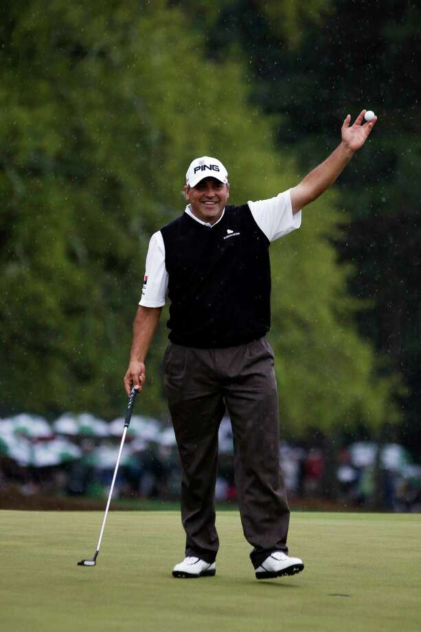 Angel Cabrera, of Argentina, holds up his ball after birdie putt on the 18th hole during the fourth round of the Masters golf tournament Sunday, April 14, 2013, in Augusta, Ga. (AP Photo/Darron Cummings) Photo: Darron Cummings, Associated Press / AP
