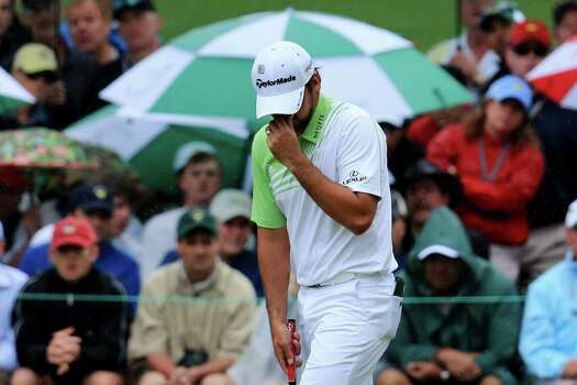 AUGUSTA, GA - APRIL 14:  Jason Day of Australia reacts after missing a birdie putt on the 18th green during the final round of the 2013 Masters Tournament at Augusta National Golf Club on April 14, 2013 in Augusta, Georgia. Photo: David Cannon, Getty Images / 2013 Getty Images