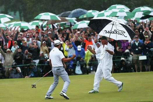AUGUSTA, GA - APRIL 14:  Adam Scott of Australia celebrates with caddie Steve Williams after making a birdie on the 18th hole during the final round of the 2013 Masters Tournament at Augusta National Golf Club on April 14, 2013 in Augusta, Georgia. Photo: Mike Ehrmann, Getty Images / 2013 Getty Images
