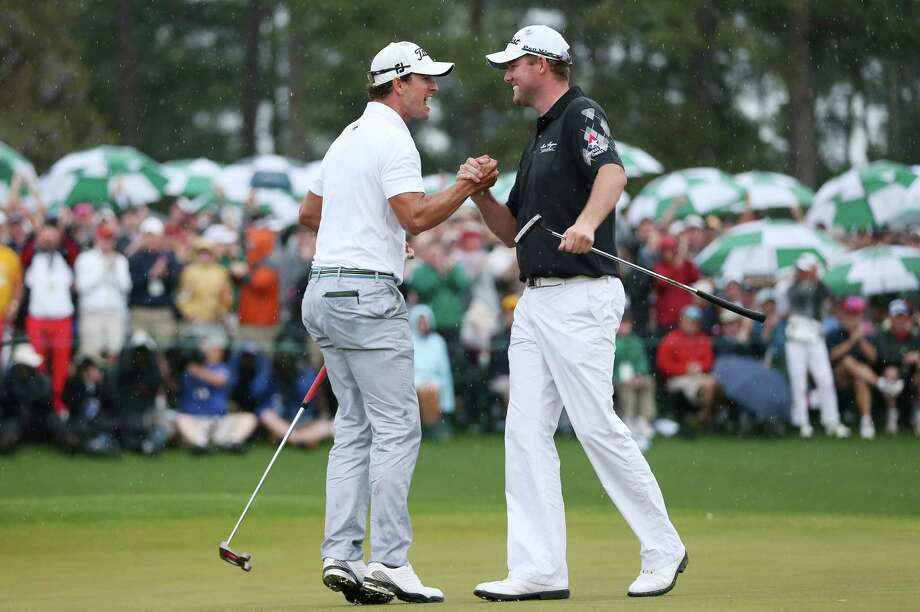 AUGUSTA, GA - APRIL 14:  (L-R) Adam Scott of Australia celebrates with Marc Leishman of Australia after Scott makes a birdie on the 18th hole during the final round of the 2013 Masters Tournament at Augusta National Golf Club on April 14, 2013 in Augusta, Georgia. Photo: Andrew Redington, Getty Images / 2013 Getty Images