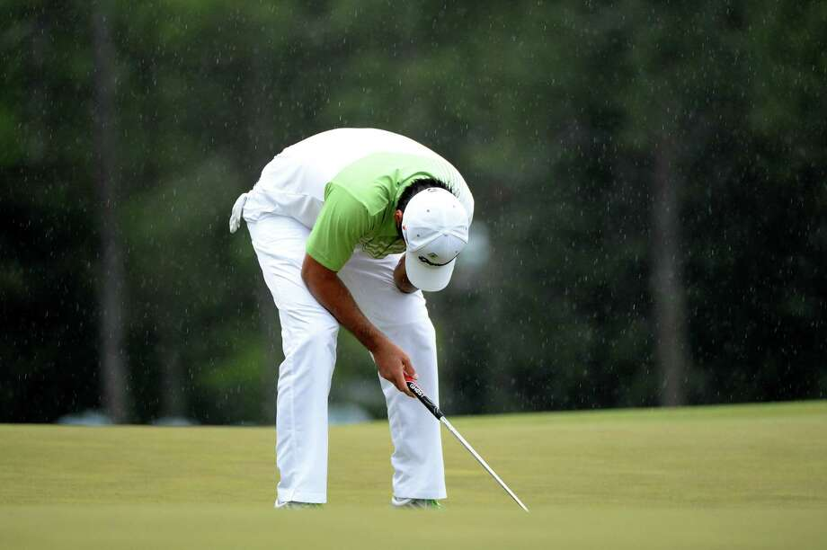 AUGUSTA, GA - APRIL 14:  Jason Day of Australia reacts after missing a birdie putt on the 18th green during the final round of the 2013 Masters Tournament at Augusta National Golf Club on April 14, 2013 in Augusta, Georgia. Photo: Harry How, Getty Images / 2013 Getty Images