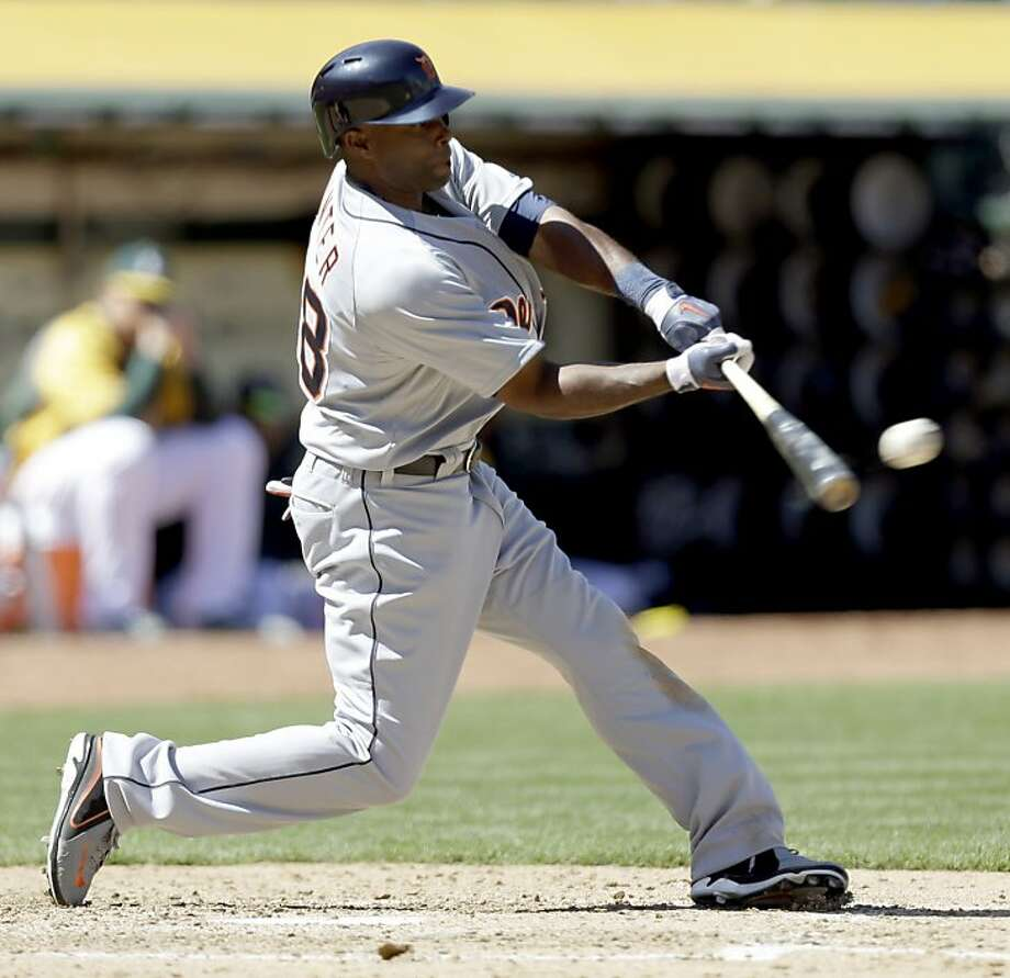 Detroit Tigers' Torii Hunter connects for a triple off Oakland Athletics' Evan Scribner in the sixth inning of a baseball game, Sunday, April 14, 2013, in Oakland, Calif. (AP Photo/Ben Margot) Photo: Ben Margot, Associated Press