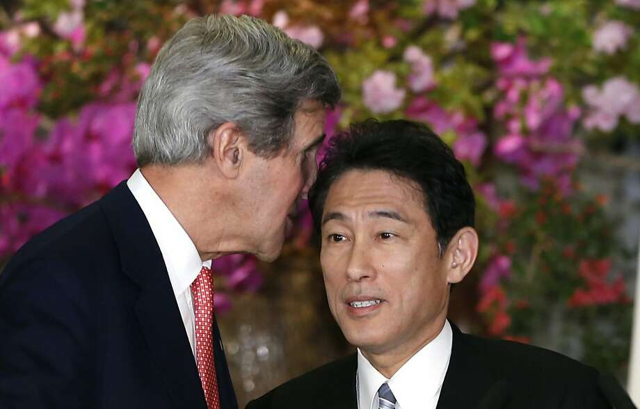 U.S. Secretary of Sate John Kerry, left, whispers to Japanese Foreign Minister Fumio Kishida as they shake hands after their joint press conference at Foreign Ministry's Iikura Guesthouse in Tokyo, Sunday, April 14, 2013. Kerry and Kishida said their countries are committed to new talks with North Korea if the reclusive communist government begins abiding by previous agreements on its nuclear program. (AP Photo/Shizuo Kambayashi) Photo: Shizuo Kambayashi, Associated Press