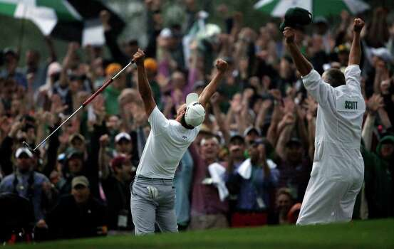 Adam Scott, of Australia, celebrates with caddie Steve Williams after making a birdie putt on the second playoff hole to win the Masters golf tournament Sunday, April 14, 2013, in Augusta, Ga. (AP Photo/Matt Slocum) Photo: Matt Slocum, Associated Press / AP