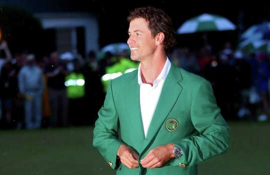 AUGUSTA, GA - APRIL 14:  Adam Scott of Australia celebrates while wearing his green jacket after winning the 2013 Masters Tournament at Augusta National Golf Club on April 14, 2013 in Augusta, Georgia. Photo: Mike Ehrmann, Getty Images / 2013 Getty Images