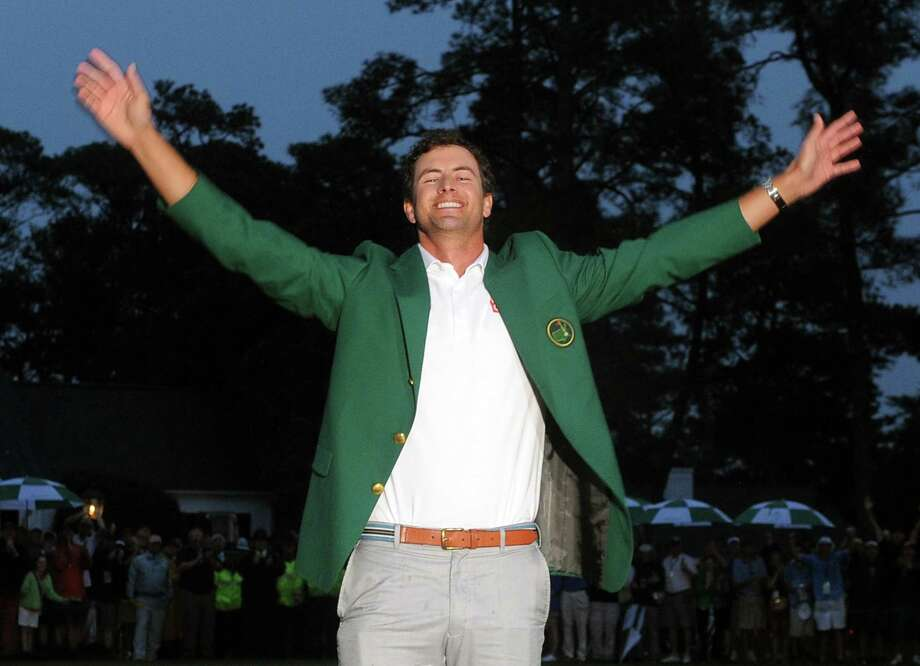 Adam Scott of Australia celebrates during the Green Jacket Ceremony after defeating Angel Cabrera of Argentina on the 10th hole during a playoff at the fourth round of the 77th Masters golf tournament at Augusta National Golf Club on April 14, 2013 in Augusta, Georgia.  AFP PHOTO /  JEWEL SAMADJEWEL SAMAD/AFP/Getty Images Photo: JEWEL SAMAD, AFP/Getty Images / AFP
