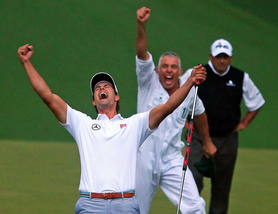 Adam Scott and his caddie, Steve Williams, exult after Scott's birdie putt on the second hole of sudden death secured a first Masters win for Australia. Scott started the final round one shot behind the co-leaders. Photo: Curtis Compton, McClatchy-Tribune News Service