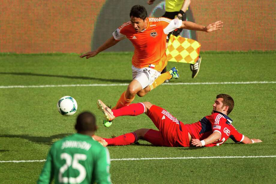 Houston Dynamo forward Brian Ching (25) is tripped up by Chicago Fire defender Gonzalo Segares (13) as he runs toward the goal during the second half of an MLS soccer game at BBVA Compass Stadium Sunday, April 14, 2013, in Houston. The Dynamo beat the Fire 2-1 to stretch its home unbeaten streak to 35 straight games at home. Photo: Brett Coomer, Houston Chronicle / © 2013 Houston Chronicle