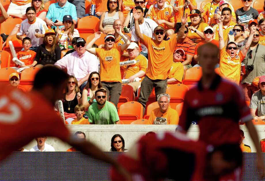 Houston Dynamo fans cheer the Dynamo's first goal against the Chicago Fire during the first half of and MLS soccer game at BBVA Compass Stadium Sunday, April 14, 2013, in Houston. The Dynamo beat the Fire 2-1 to stretch its home unbeaten streak to 35 straight games at home. Photo: Brett Coomer, Houston Chronicle / © 2013 Houston Chronicle