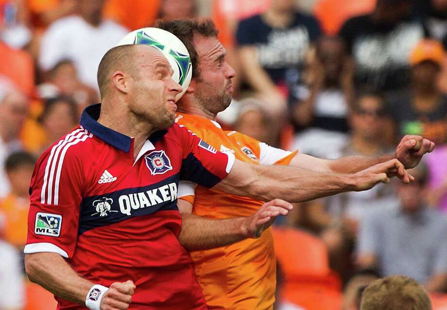 Chicago Fire midfielder Joel Lindpere (26) and Houston Dynamo midfielder Adam Moffat (16) head a ball during the first half of and MLS soccer game at BBVA Compass Stadium Sunday, April 14, 2013, in Houston. The Dynamo beat the Fire 2-1 to stretch its home unbeaten streak to 35 straight games at home. Photo: Brett Coomer, Houston Chronicle / © 2013 Houston Chronicle