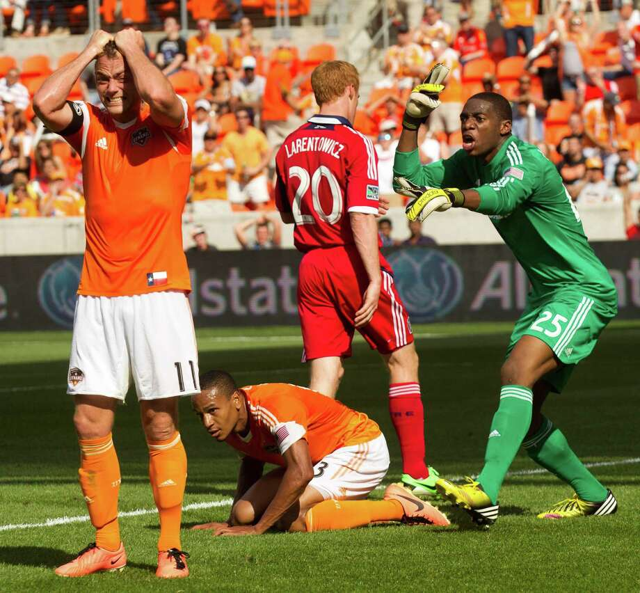 Houston Dynamo midfielder Brad Davis (11) reacts to a missed shot on goal as Chicago Fire goalkeeper Sean Johnson (25) argues for a call during the first half of and MLS soccer game at BBVA Compass Stadium Sunday, April 14, 2013, in Houston. The Dynamo beat the Fire 2-1 to stretch its home unbeaten streak to 35 straight games at home. Photo: Brett Coomer, Houston Chronicle / © 2013 Houston Chronicle